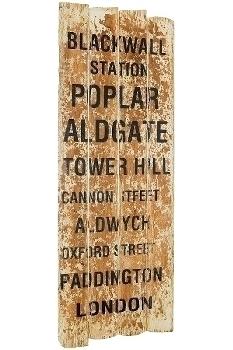 "board with slogans ""Blackwall Station"""