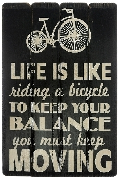 """board with slogans """"Life is like riding a bicycle"""""""