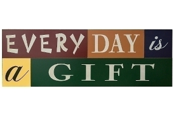 """board with slogans """"Every day is a gift"""""""